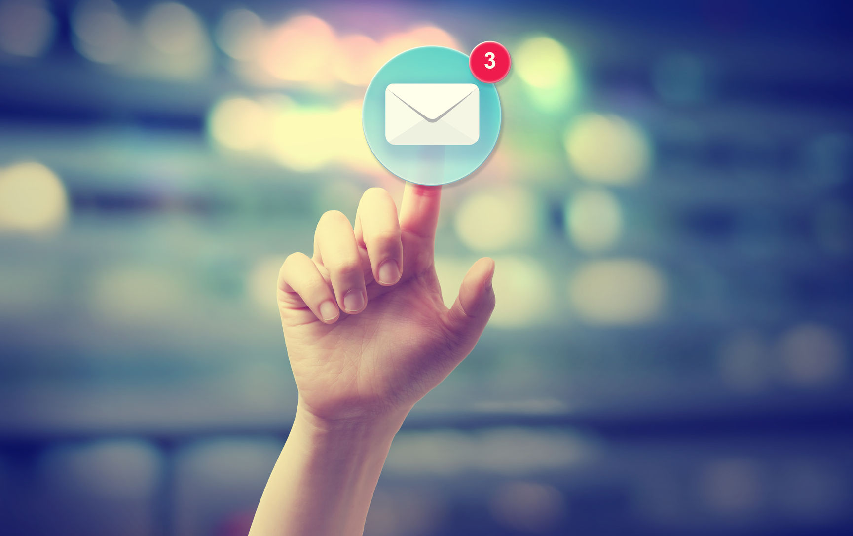 43317885 Hand Pressing An Email Icon On Blurred Cityscape Background