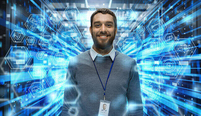 Shot Of A Smiling It Engineer Standing In The Middle Of A Working Data Center Server Room Visualizations Of Data Transmission Through High Speed Internet User Interface Icons In The Foreground